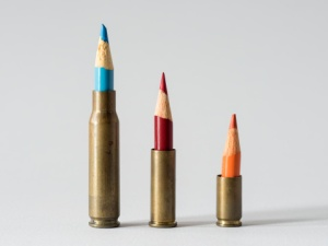513388943-bullet-shells-with-crayons-as-projectiles-gettyimages